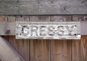The original house plate name, carved by the son of Charles Townsend, now on the shed